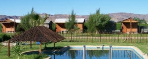 Image of a fenced pool and chalets to show what the surrounding area looks like